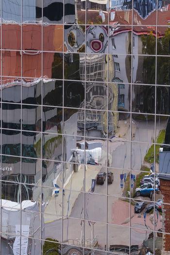Full frame shot of building seen through glass window