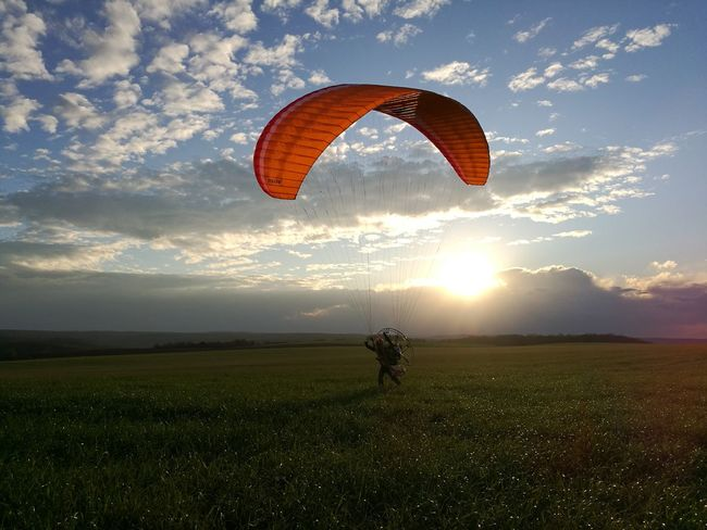 sport extreme sports landscape sunset sky Field Paragliding flying adventure day people outdoors Nature Grass cloud - sky HuaweiP9 Sport Extreme Sports Landscape Sunset Sky Field Paragliding Flying Adventure Day People Outdoors Nature Grass Cloud - Sky Adult Motorparagliding One Man Only One Person No Filter Lifestyles Men
