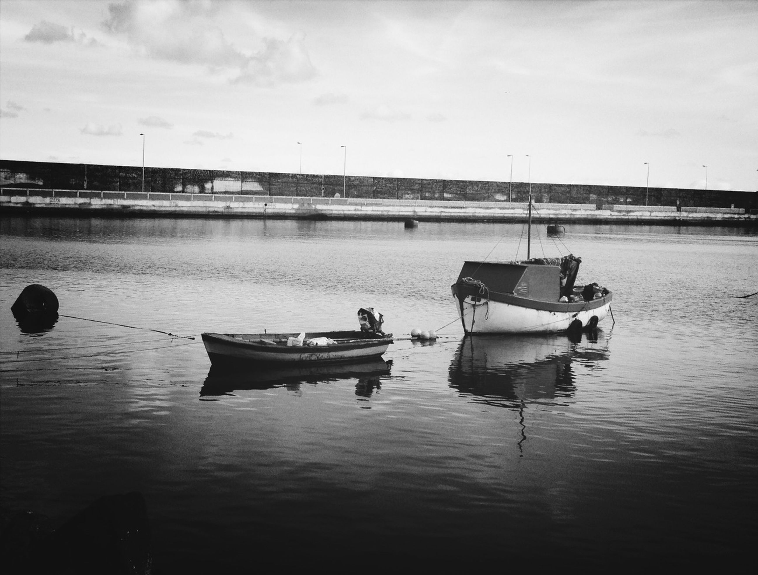 nautical vessel, transportation, boat, water, mode of transport, moored, sea, sky, waterfront, tranquility, tranquil scene, travel, nature, outdoors, river, day, rippled, reflection, pier, beauty in nature