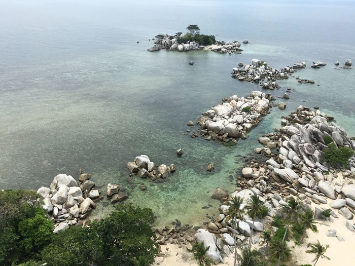 Flying High at Lengkuas_island Lengkuasisland Sea High Angle View Water Nature Beauty In Nature Rock - Object Scenics Tranquility Outdoors Tranquil Scene No People Day Sky Horizon Over Water - Belitung Island No Filter