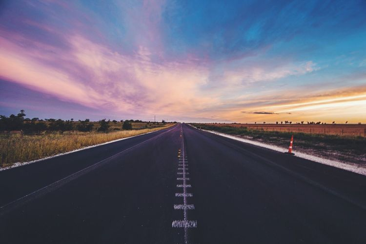 Empty Road On Field Against Sky During Sunset