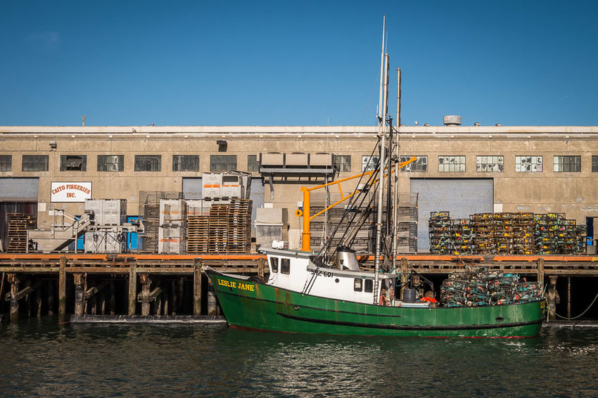 Leslie Jane - A dungeness crab fishing boat loaded with crab pots prepares to head out for the day at San Francisco's Fisherman's Wharf. Fisherman's Wharf San Francisco Boats