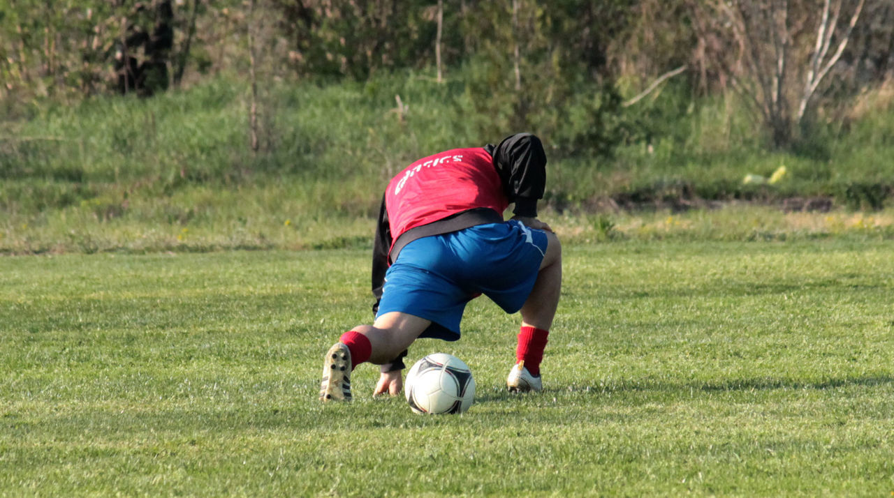 Soccer Player With Ball On Grassy Field