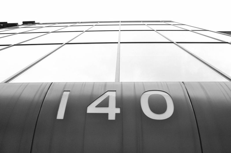 Low angle view of numbers on building against sky