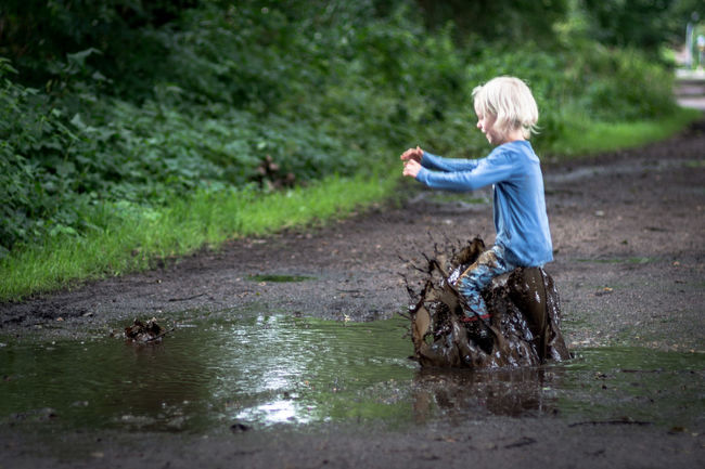 Landing EyeEm Best Shots Fun Jump Kids Kids Being Kids Nature Pure Blond Hair Childhood Children Only Day Dirt Dirty Full Length Girl Jumping Kidsphotography Little Girl Muddy Nature One Person Outdoors Puddle Rubber Boots EyeEm Ready   EyeEmNewHere