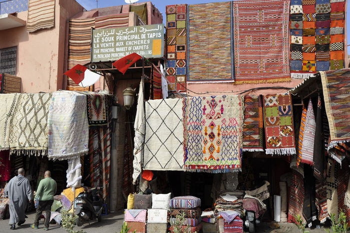 Africa Carpet Carpet Design For Sale Market Market Stall Marrakesh Morocco Multi Colored Old Town Outdoors Sale Shop Street Photography Trading Trading Area Trading Center Traditional Traditional Culture Weaving Feel The Journey