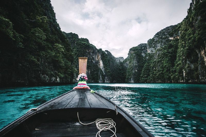 Keep exploring 🌐 Thailand Nature Water Beauty In Nature Outdoors Sea Scenics No People Perspectives On Nature EyeEmNewHere Day Nautical Vessel Transportation Nature Mode Of Transport Sky Longtail Boat Mountain Cloud - Sky Tree Landscape The Great Outdoors - 2018 EyeEm Awards