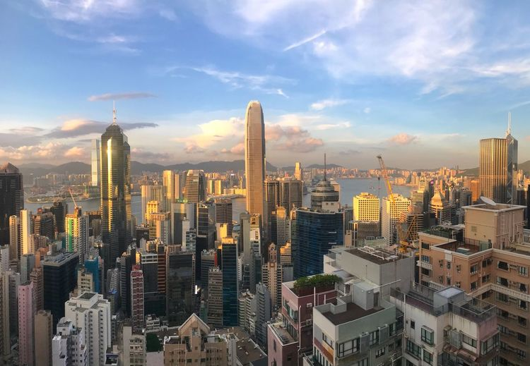 Sunset in Hong Kong Urban Skyline Urban Jungle Hong Kong Sunset Building Exterior Architecture Built Structure Building Cityscape Office Building Exterior City Sky Skyscraper Travel Destinations Crowded Modern Tall - High Cloud - Sky