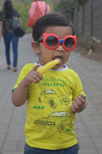 Full length of boy wearing sunglasses standing outdoors