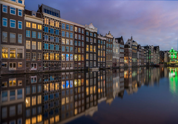 Amsterdam Architecture Building Exterior Built Structure City Damrak Day Illuminated Night No People Outdoors Reflection Sky Skyline Sunset Water Waterfront