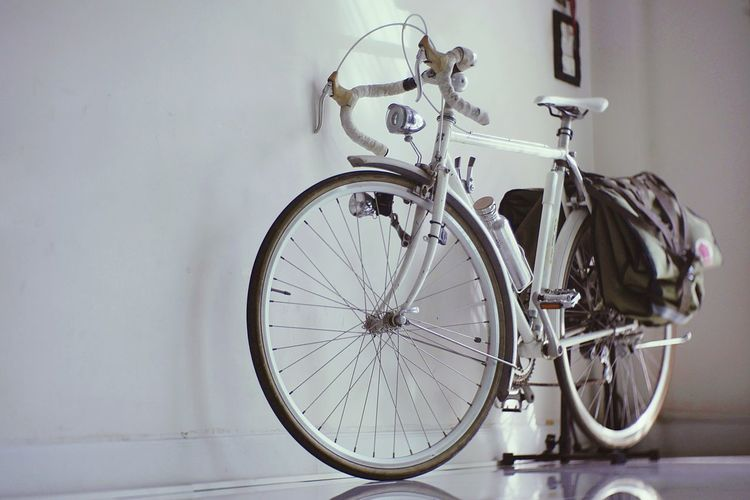 White touring bicycle in vintage style. City Tire Stationary Bicycle Pedal Land Vehicle Close-up