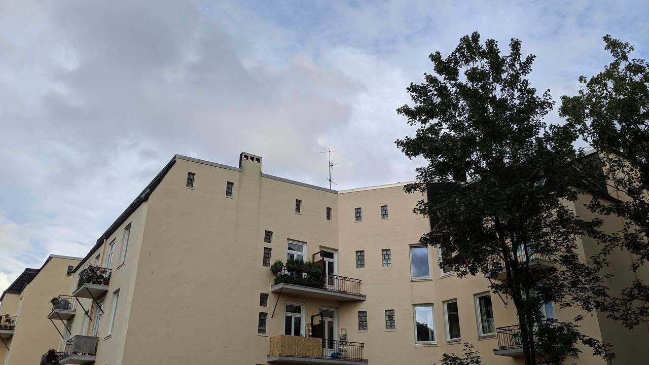 LOW ANGLE VIEW OF RESIDENTIAL BUILDINGS IN TOWN