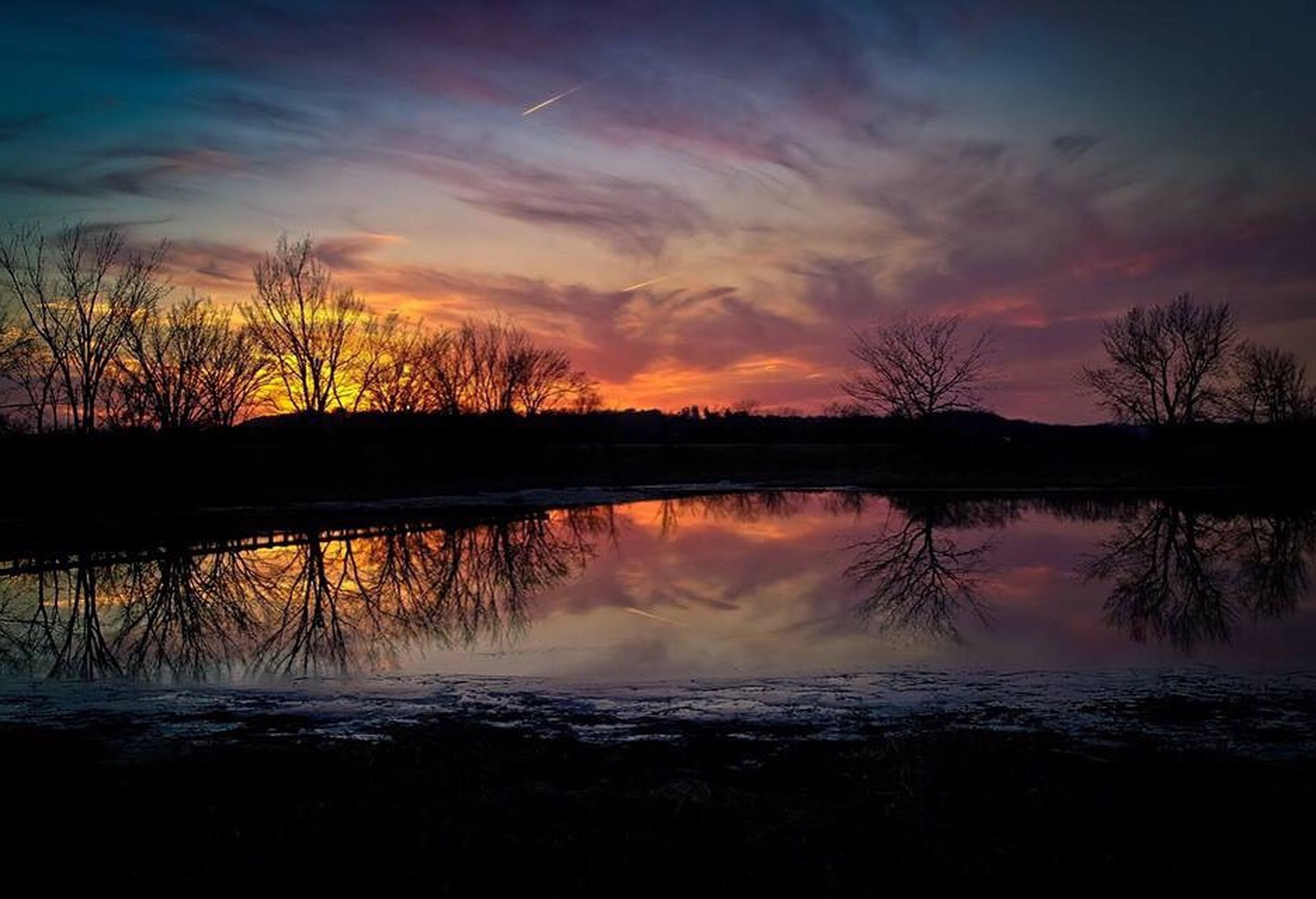 sunset, reflection, water, scenics, silhouette, lake, tranquil scene, bare tree, tranquility, beauty in nature, orange color, nature, sky, majestic, branch, romantic sky, non-urban scene, outdoors, multi colored, dramatic sky, no people, remote, non urban scene, standing water