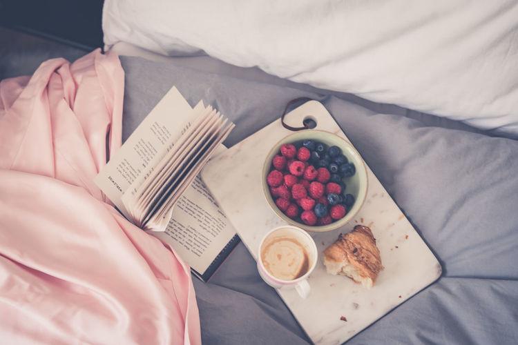 Breakfast Bed Berry Fruit Breakfast Croissant Food Food And Drink Freshness Fruit Furniture Hand Healthy Eating High Angle View Holding Human Body Part Indoors  Meal One Person Plate Real People Table Wellbeing