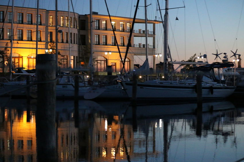 Abendstimmung Am See Abendstimmung Im Hafen Abendstimmung Am Meer Architecture Building Exterior Built Structure Canal City Harbor Illuminated Marina Mast Mode Of Transportation Moored Nature Nautical Vessel No People Outdoors Reflection Sailboat Sky Sunset Transportation Water Waterfront