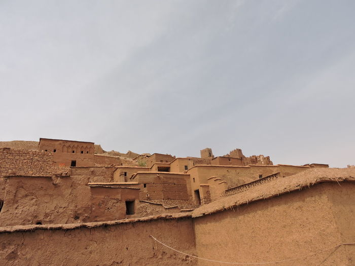 Low angle view of old ruin building against sky