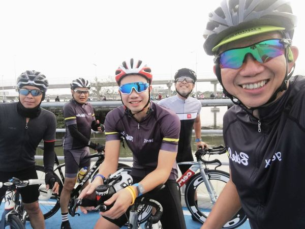 Sunday thing. Bicycle Track Bicycle Sky Lane Cyclist Cycling Headwear Young Adult Sport Young Men Looking At Camera Adventure Day Outdoors Leisure Activity Happiness Smiling Cycling Helmet Lifestyles