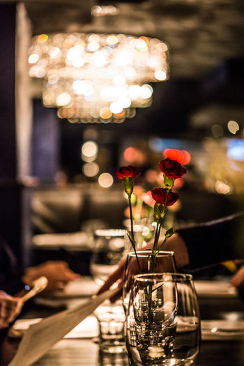 Close-up of glass vase on table in restaurant