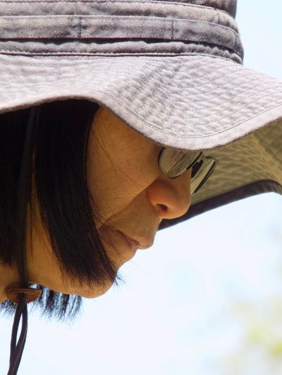 Close-up of woman holding umbrella