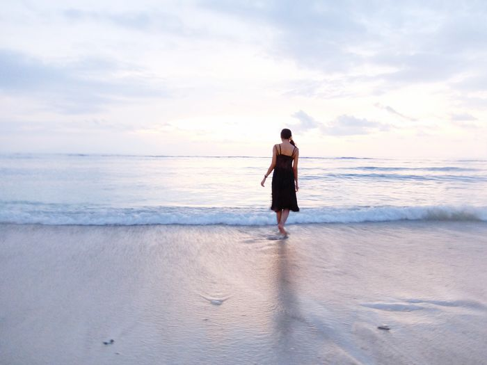 Woman wading in sea