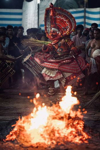 Theyyam of Kannur - Kerala, India Firewood Kannurphotos Indian Culture  Travelling Travel Photography Traveling Travel Travel Destinations Kannur Kerala, India Theyyams Of Kannur Kerala Theyyam Kerala India Portrait Portrait Photography Portrait Of A Man  India Indian Burning Fire Flame Fire - Natural Phenomenon Heat - Temperature Celebration No People Illuminated Event Belief Religion