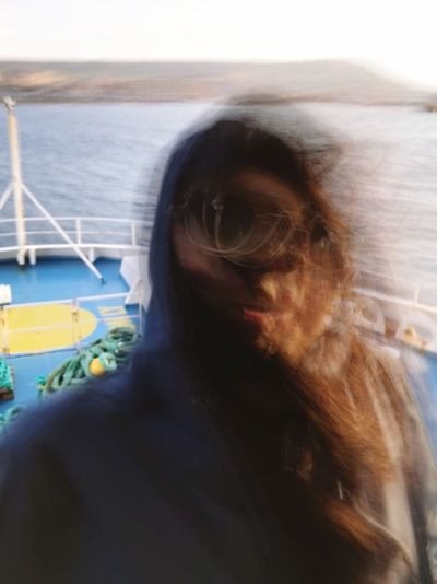 The ferry was too bumping One Person Lifestyles Real People Portrait Sea Headshot Water Close-up Transportation Outdoors Women Hair