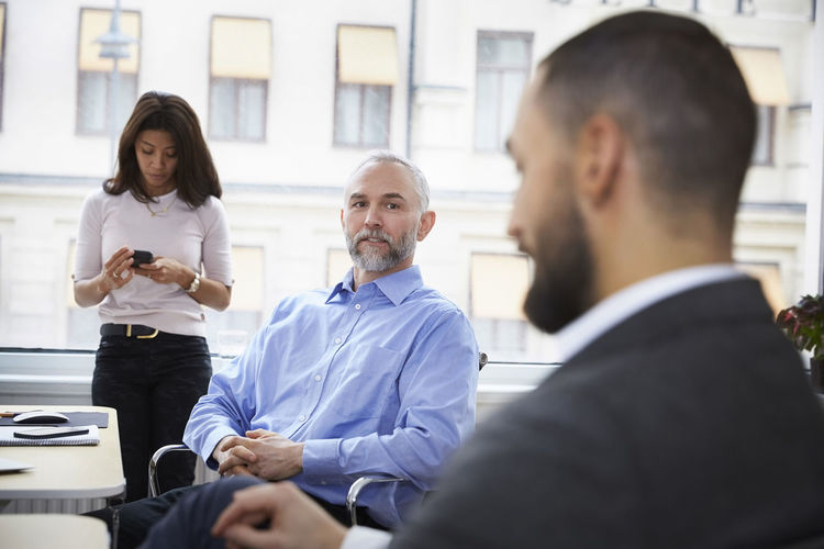 Group of people sitting in office