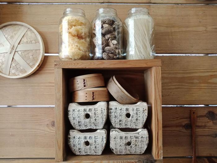 Food in jars on rack against wall