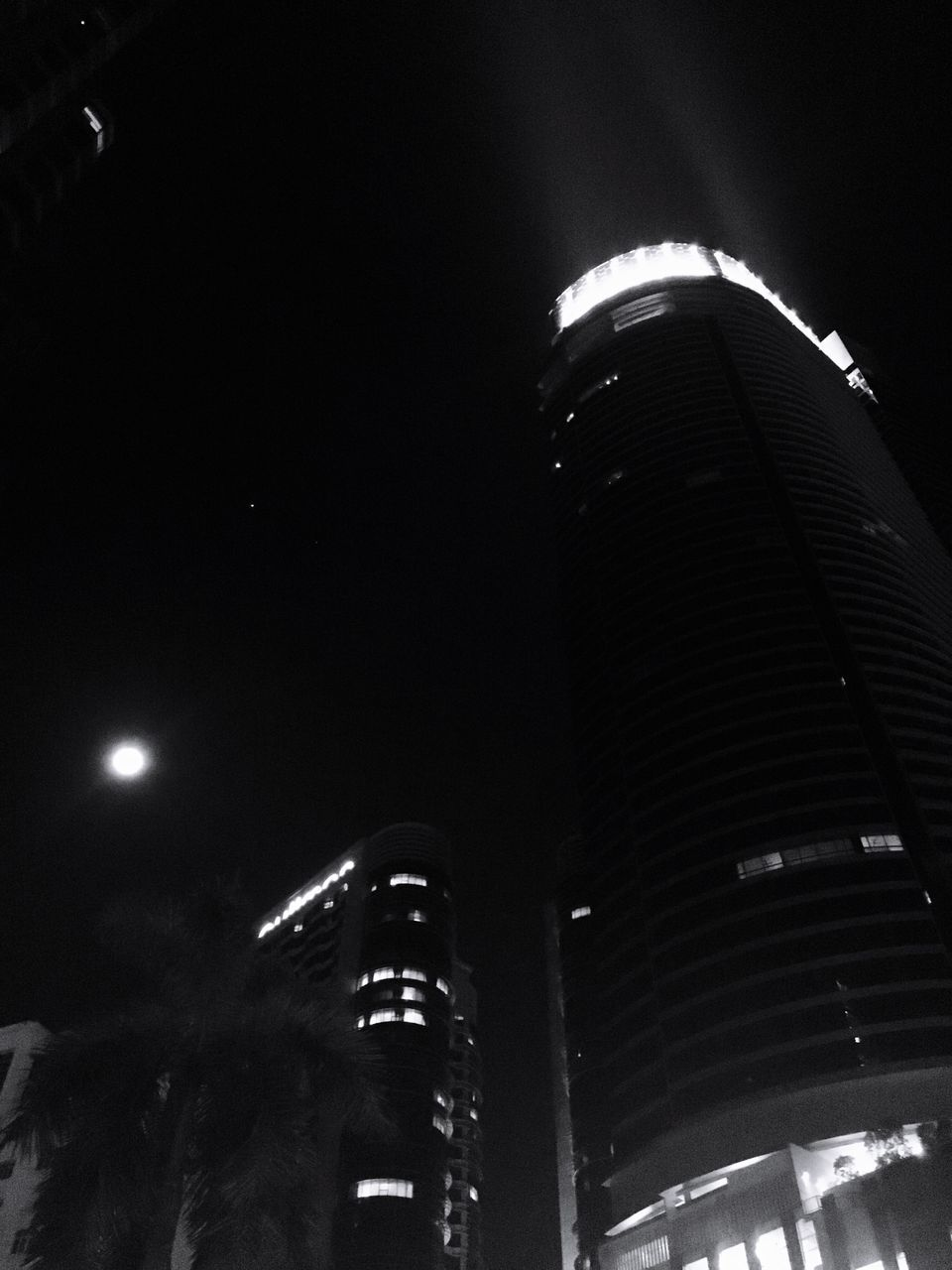 illuminated, night, architecture, city, low angle view, modern, built structure, building exterior, city life, skyscraper, no people, outdoors, sky