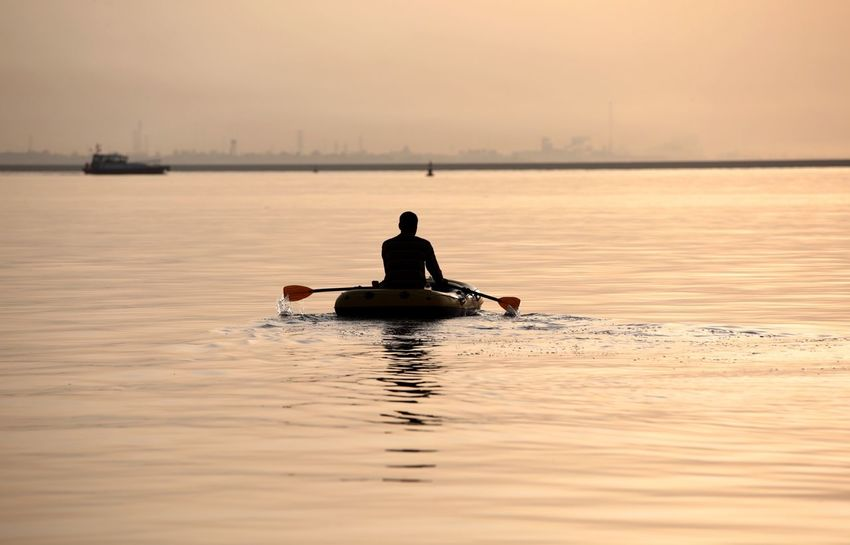 Fishingboat Water Nautical Vessel Transportation Sky One Person Sea Mode Of Transportation Nature Sunset Rowing Beauty In Nature Men Reflection Outdoors Sitting Occupation Silhouette Rear View