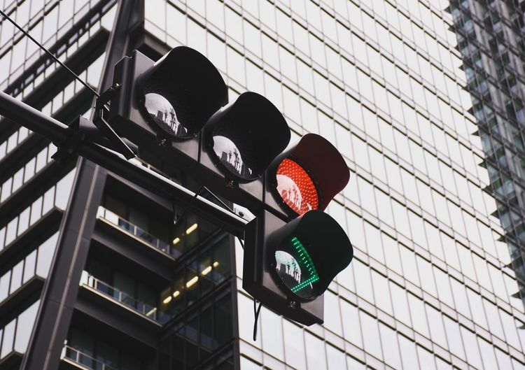 Low angle view of traffic light against building