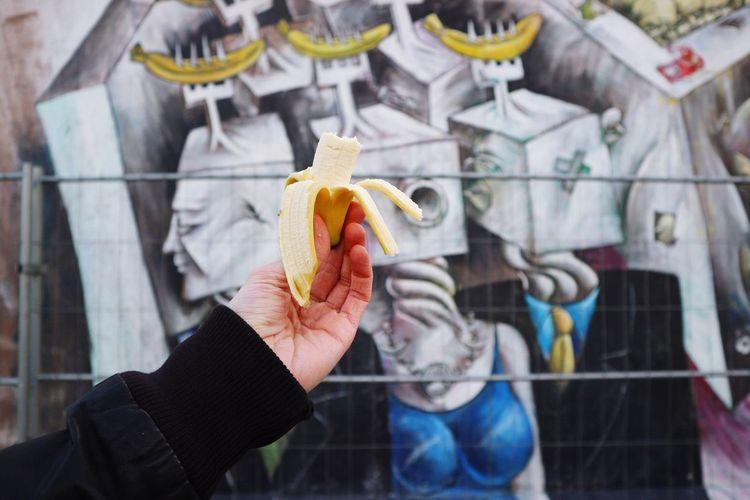 Cropped Hand Holding Banana