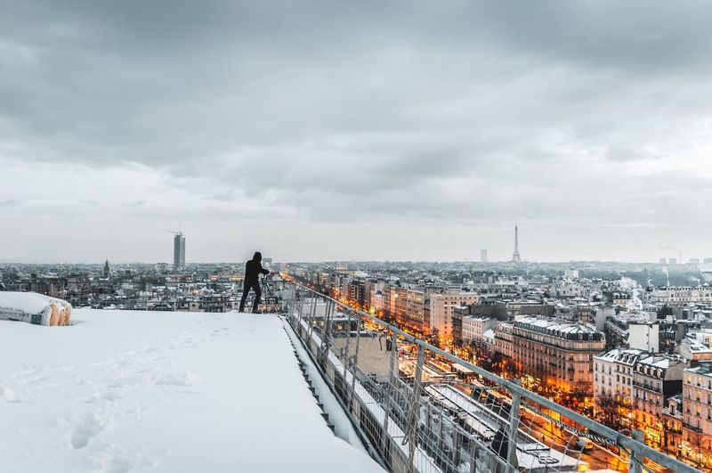 Snowy roof Snowing Snow Nikon Paris, France  Paris Urbanexploration Urbexphotography Urbex Rooftop Roof Snow Winter Weather Cold Temperature Sky Architecture Built Structure Cloud - Sky Real People Outdoors Building Exterior Day Cityscape City Men One Person Mobility In Mega Cities