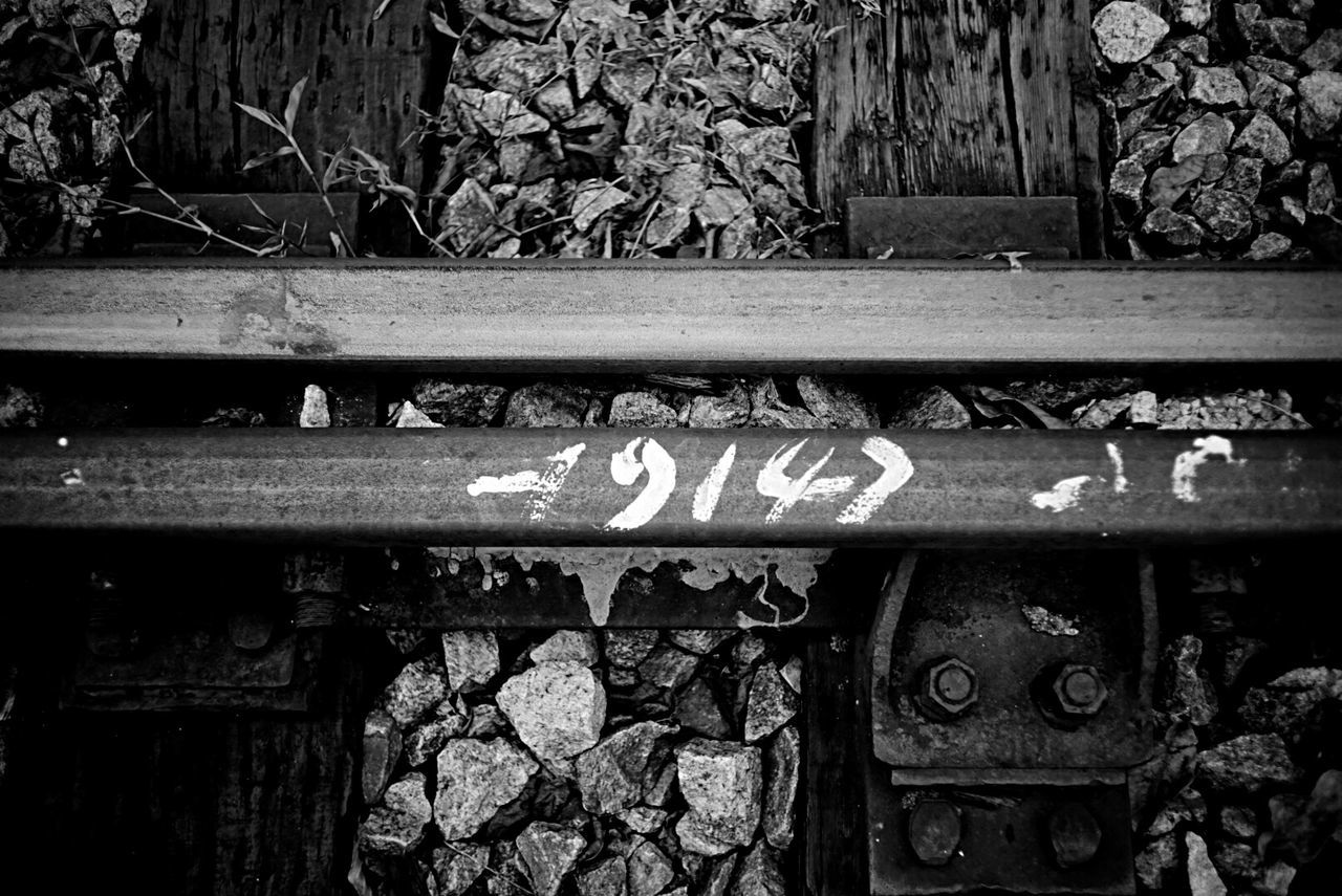 text, communication, metal, day, outdoors, no people, railroad track, rail transportation, rusty, close-up