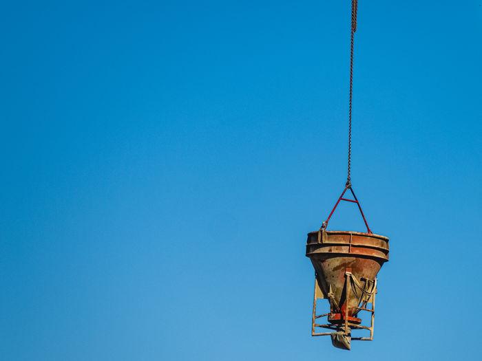 Cement mixer liften by a crane