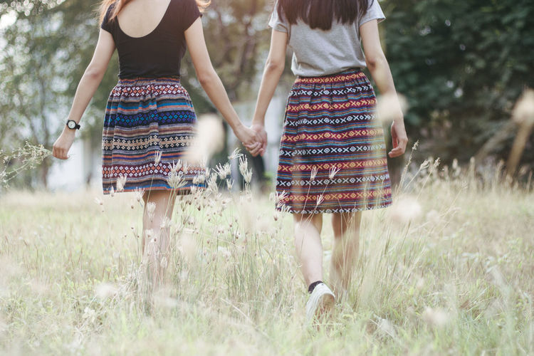 Two People Grass Women Plant Real People Togetherness Leisure Activity Day Land Field Nature Bonding Friendship Adult Emotion Casual Clothing Young Women Lifestyles People Selective Focus Outdoors Positive Emotion Couple - Relationship