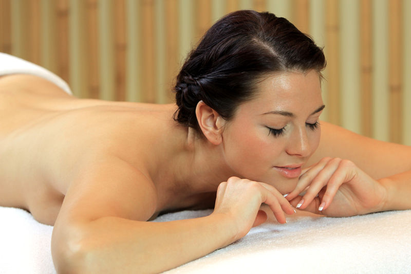 Young woman relaxing with a massage Beautiful Wellness Woman Alternative Therapy Beauty Beauty Spa Body Care Girl Health Spa Healthy Lifestyles Luxury Massage Massage Table Massage Therapy Massaging Pampering Relax Relaxation Spa Spa Treatment Treatment Wellbeing Young Adult Young Women