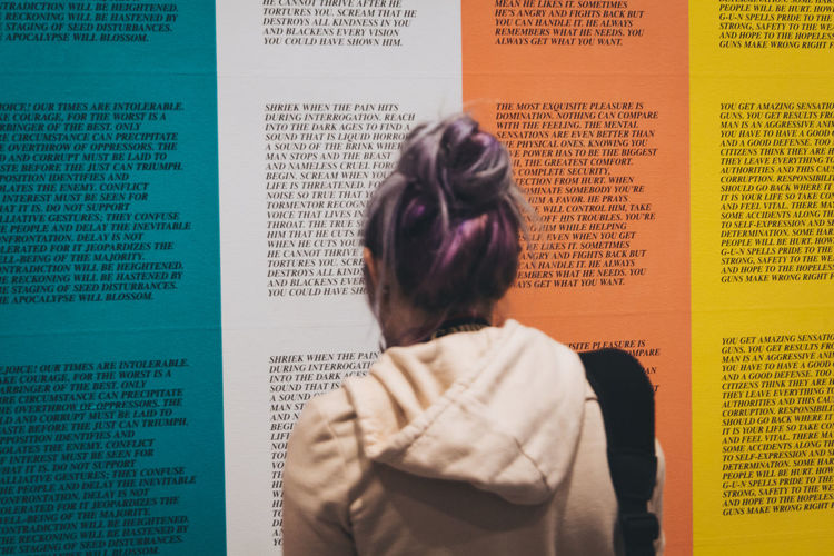 A female examines powerful quotes on display in a museum in Washington DC. - IG: @LostBoyMemoirs Streetwise Photography Streetphotography Street Photography People People Watching people and places Rear View One Person Communication Women Gallery Powerful International Women's Day 2019 The Art Of Street Photography