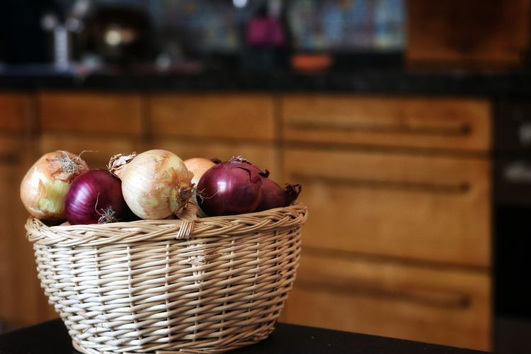 Close-up of fruits in basket on table at home