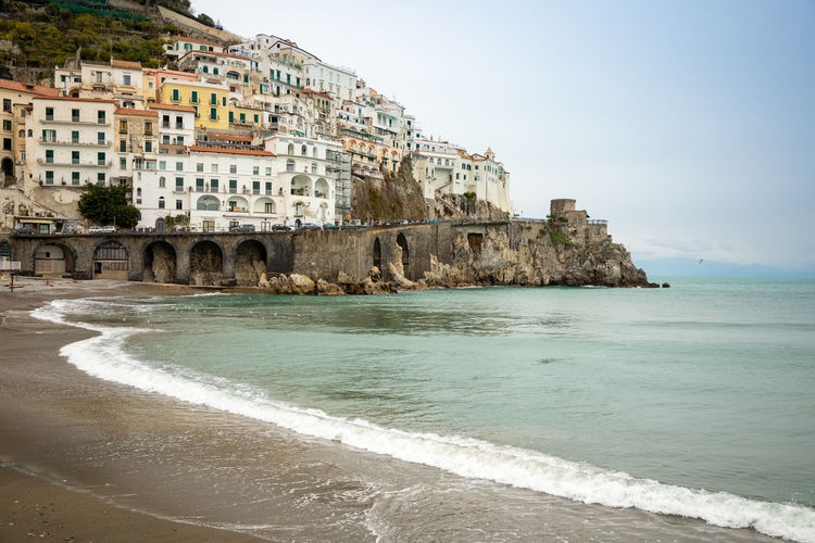 Italy Amalfi  Amalfi Coast Water Sea Built Structure Land Building Exterior Architecture Sky Beach Building Nature Surfing Motion Day Scenics - Nature Aquatic Sport Coastline Travel Destinations Wave Horizon Over Water Outdoors Flowing Water