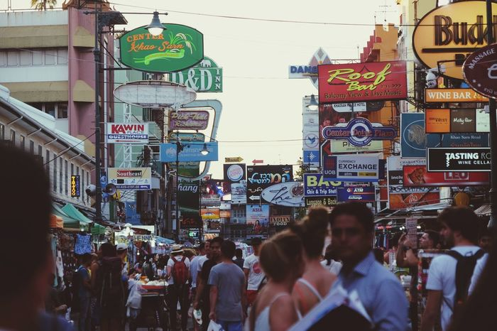Khaosan Road Night Market In Thailand Billboards Architecture Building Exterior Large Group Of People Built Structure City Text Communication Street Crowd EyeEmNewHere
