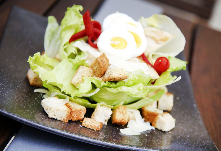 Boiled Eggs Bread Crackers Close-up Day Focus On Foreground Food Food And Drink Freshness Garnish Healthy Eating High Angle View Indoors  Indulgence Lettuce No People Plate Ready-to-eat Red Pepper Salad Serving Size SLICE Vegetable
