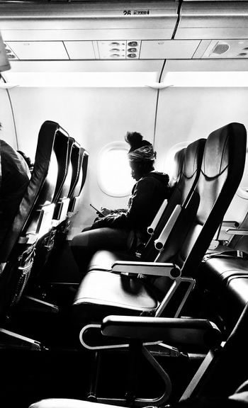 Airline Travel Flight Airplane Indoors  Real People People Sitting High Angle View Men Day Seat Lifestyles Women The Traveler - 2018 EyeEm Awards