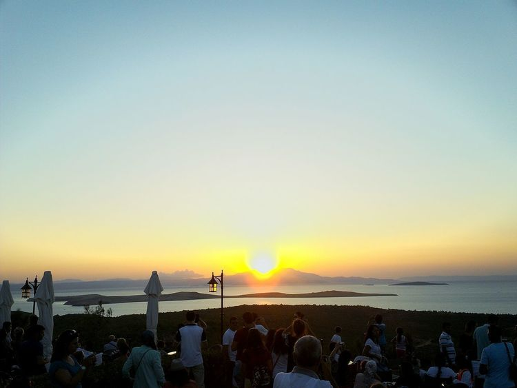 Sea Sunset Beach Nature Beauty In Nature Outdoors Water Tranquility Vacations Summer Travel Destinations Large Group Of People Tranquil Scene Scenics Sand Sun People Adult Horizon Over Water Sky Ayvalik 🐚🐳🐬🏊 şeytansofrası Turkey Eyeamphoto Travel