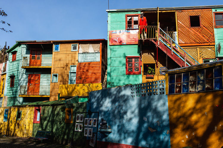 Low angle view of multi colored buildings against sky