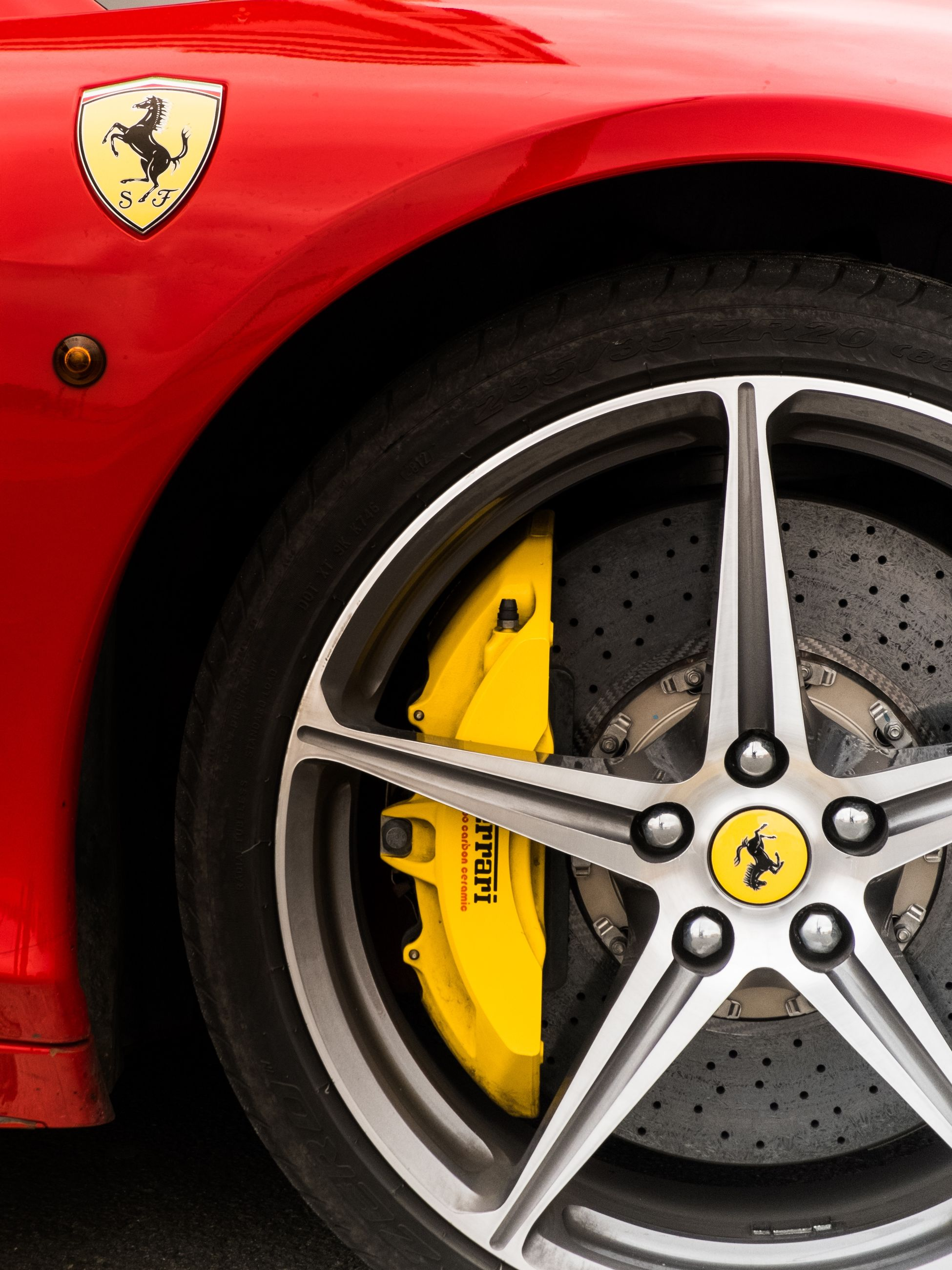 transportation, mode of transport, close-up, land vehicle, wheel, car, part of, metal, vehicle part, number, circle, old-fashioned, red, indoors, tire, high angle view, no people, machine part, metallic, old