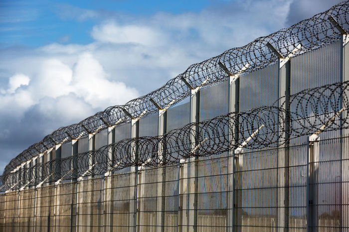 Barbed Wire Frontier Insuperable Safeguard Architecture Boarder Built Structure Calais  Cloud - Sky Clouds Country Border Danger Day Double Fence High Fences Illegal Immigration Low Angle View No People Outdoors Prison Refugees Not Welcome Sky