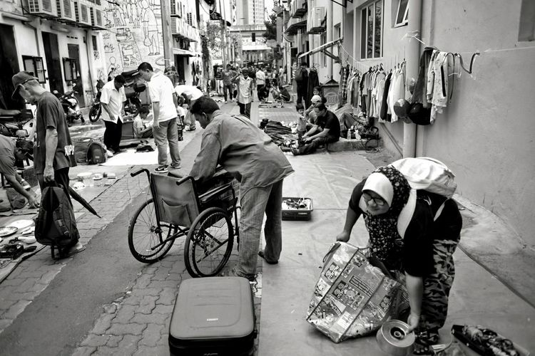 the back alley market. Wheelchair Streetphotography Blackandwhite Black And White Street Life Life Of People Malaysia City Men Full Length Women Sitting Bicycle Store Manual Worker Small Business Architecture First Eyeem Photo