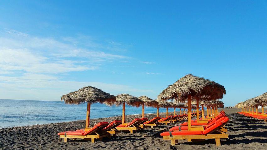 Beach Sea Beach Umbrella Summer Scenics Santorini View Santorini Greece Perissa Perissabeach Holidays In Greece ❤ Femalephotographerofthemonth