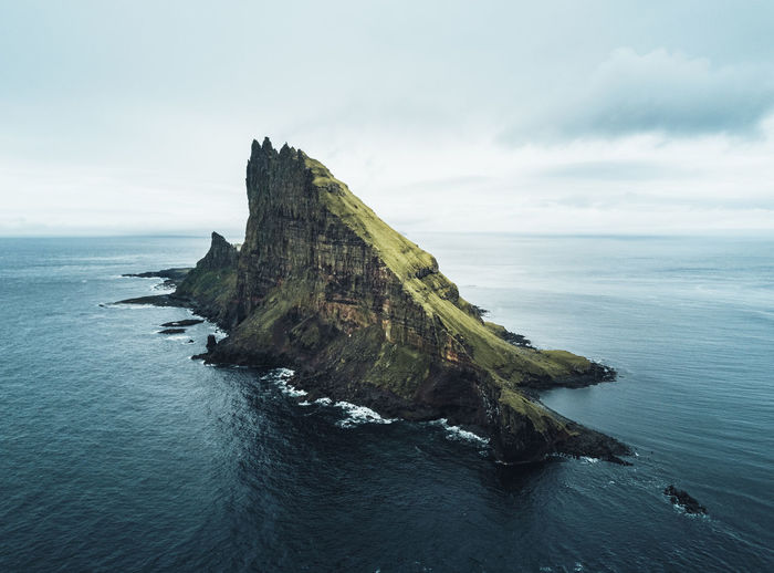 Aerial view of the rugged tindhólmur island on the faroe islands.